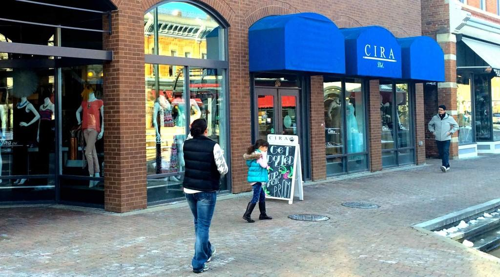 A family walks past Cira Boutique in Old Town.