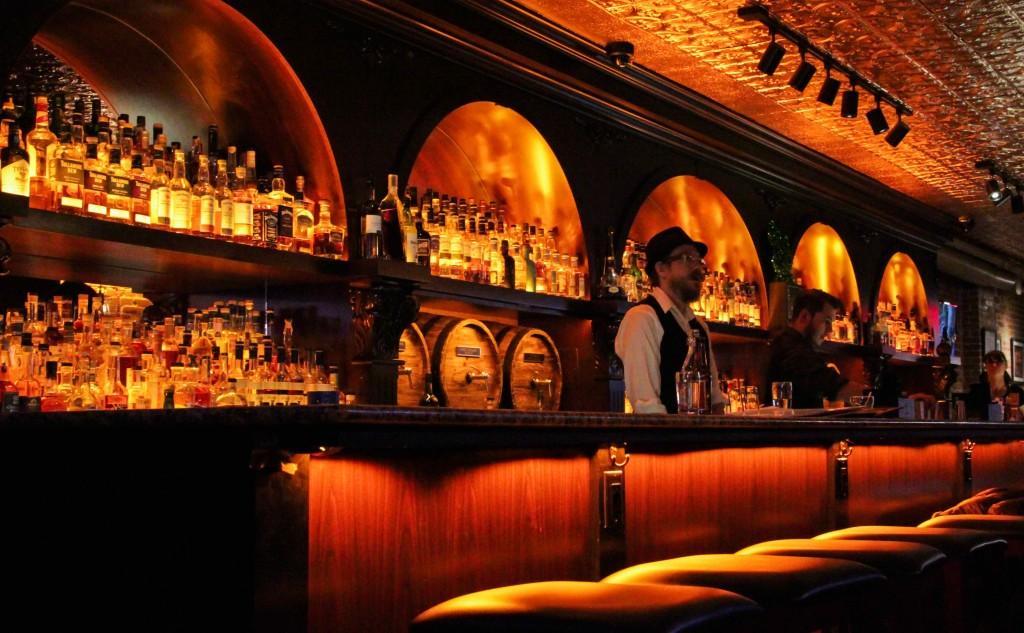 Bartender behind the Whiskey's bar.