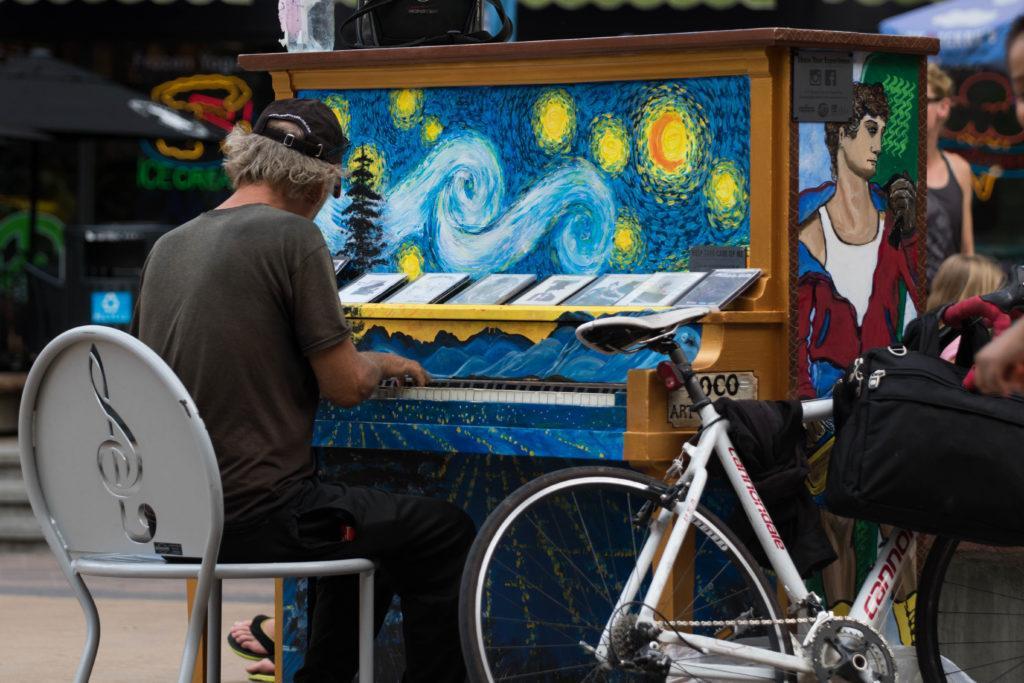 Man plays piano painted like Van Gogh's Starry Night