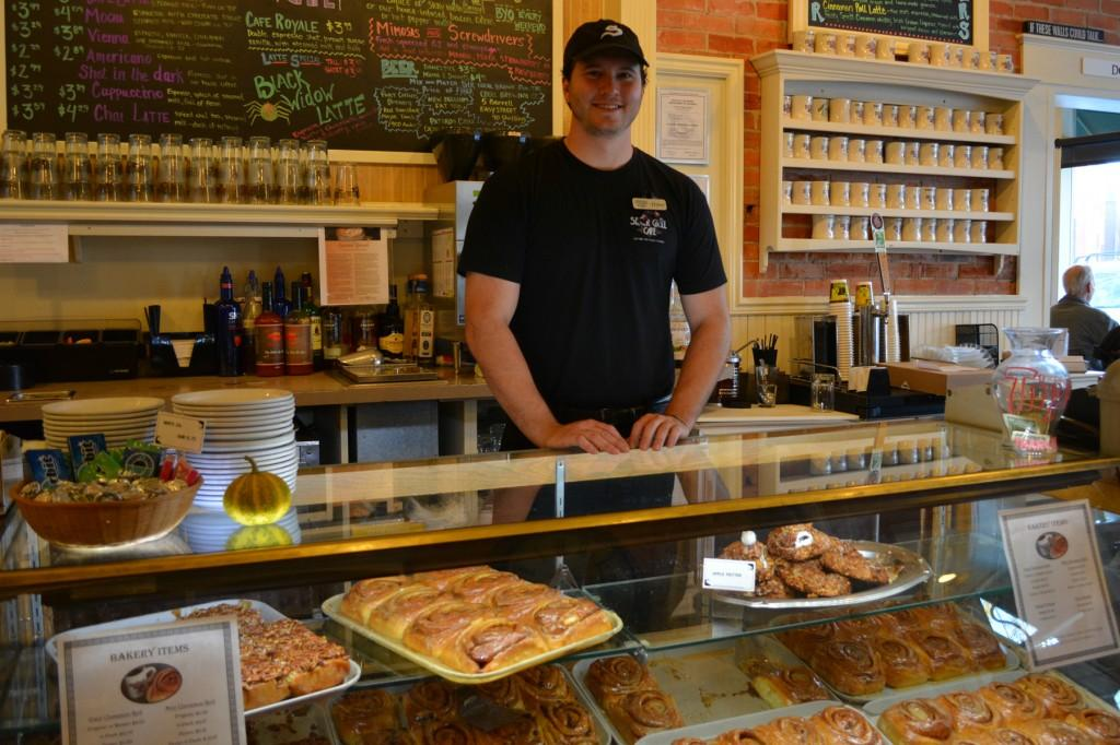 employee at the Silver Grill Café, stands ready to sell the café's famous cinnamon rolls