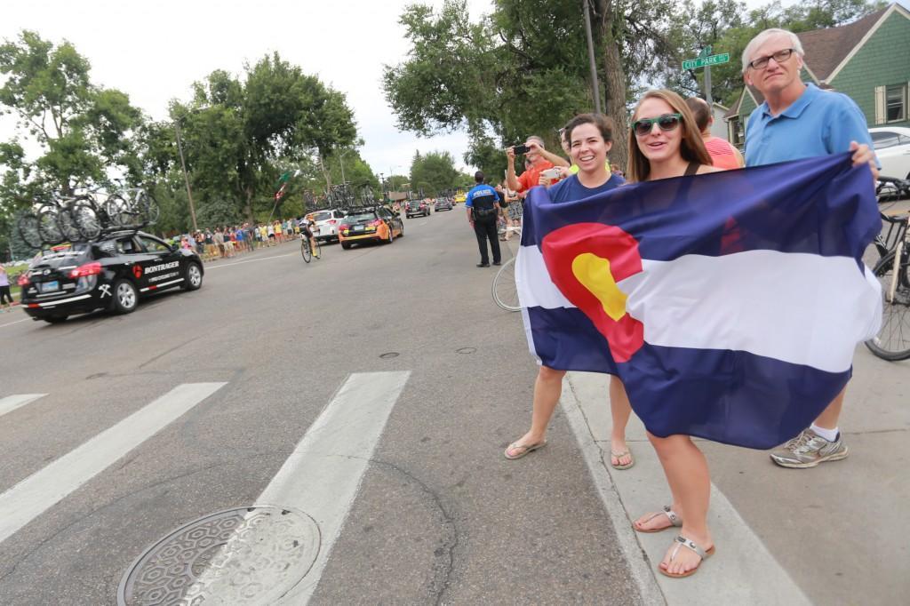 Rachel Landin holds a Colorado flag in the street