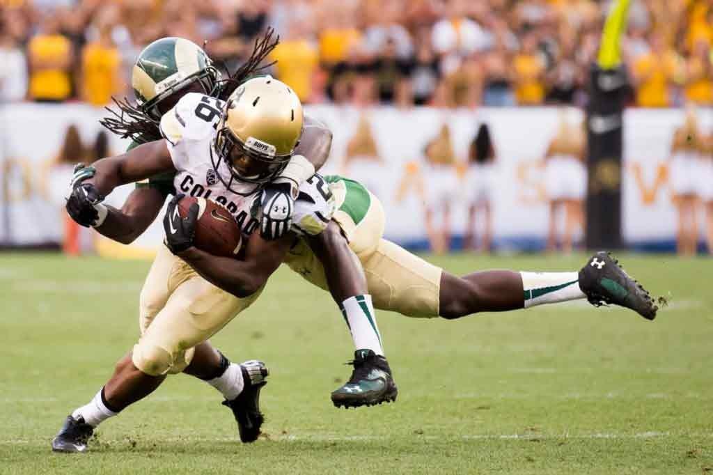 A CSU football player tackles a CU football player