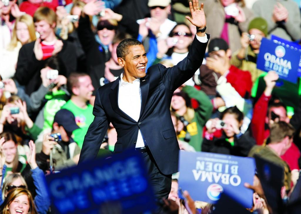 Barack Obama waving to a crowd of supporters