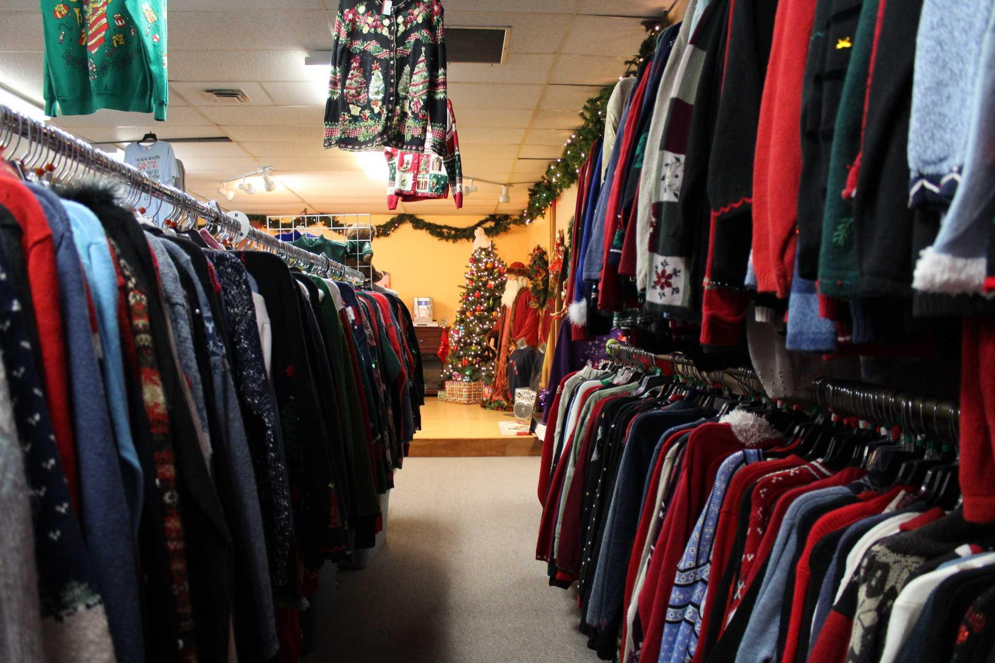 racks of ugly Christmas sweaters