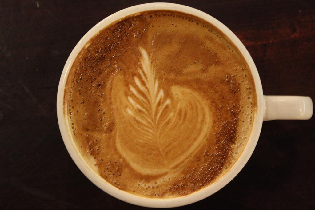 top view of a coffee cup with foam in a leaf pattern