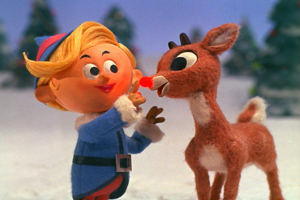 "screenshot from ""Rudolph the Red-Nosed Reindeer"" with and elf and Rudolph"
