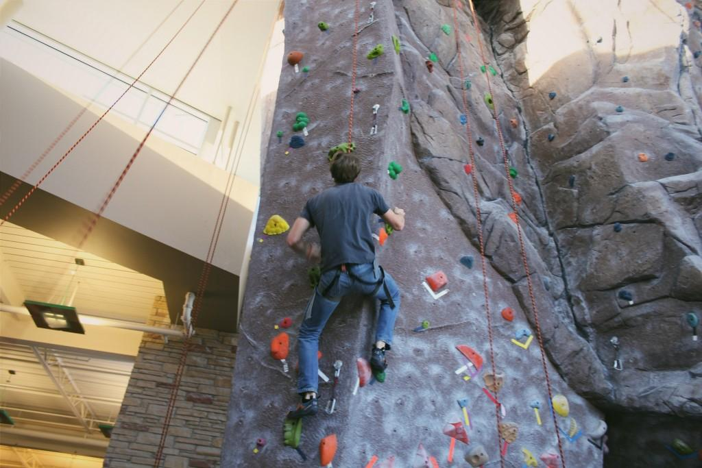person climbing CSU rock climbing wall