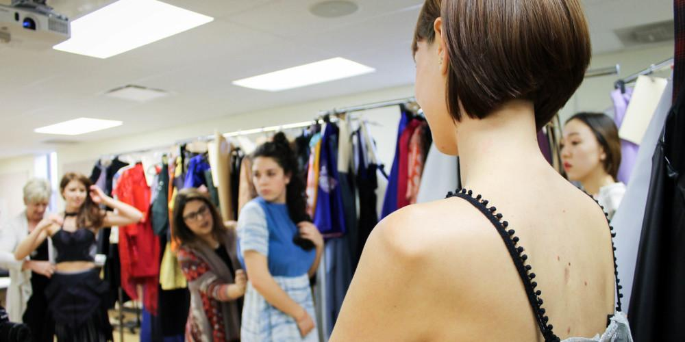 models getting fitted in the dressing room