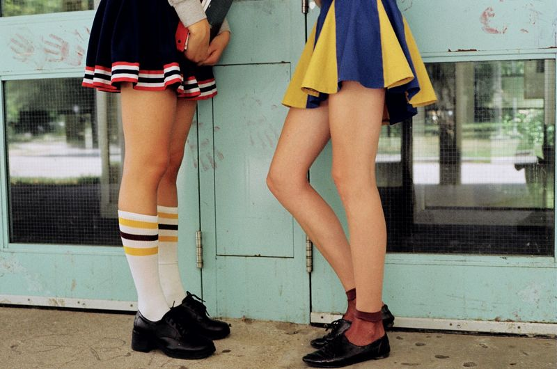 the legs of two people in skirts