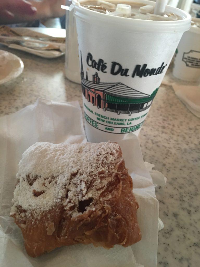 A beignet and frozen cafe au lait