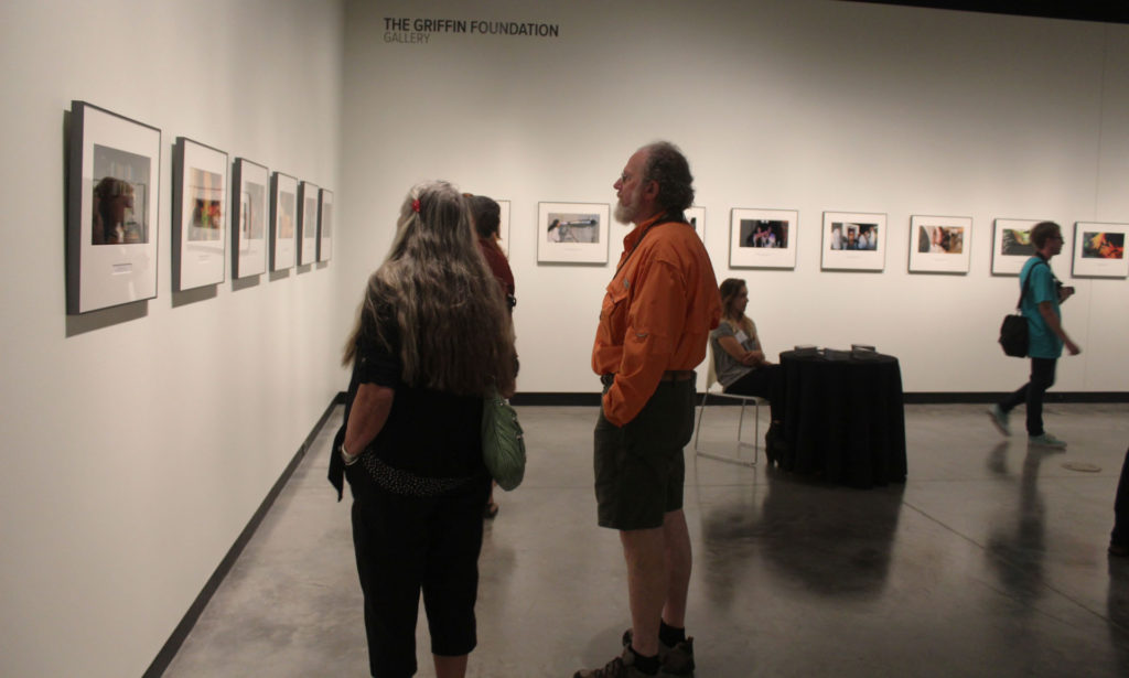 people viewing a Photography Exhibition