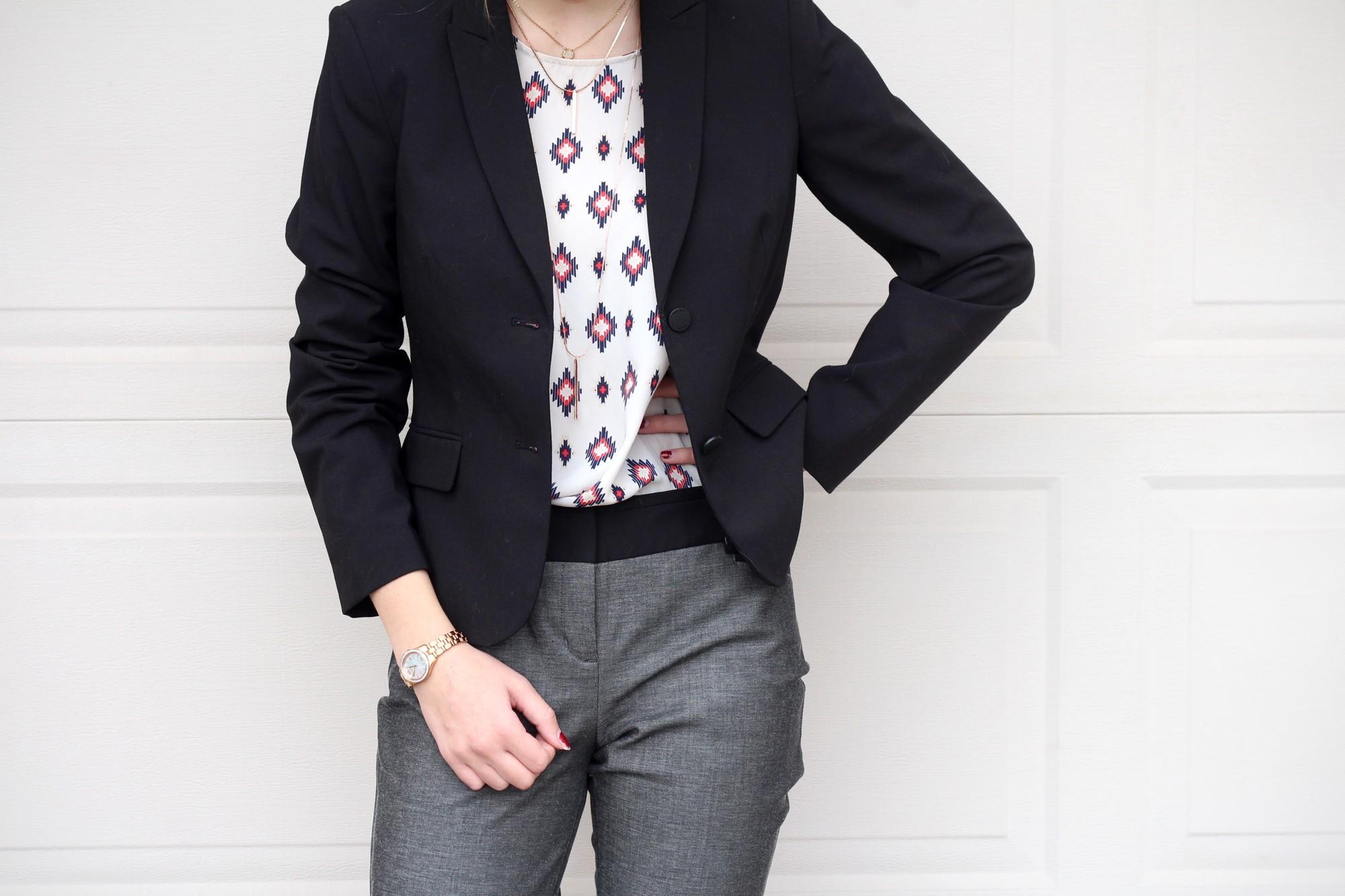 woman wearing a blazer, diamond patterned shirt, and slacks