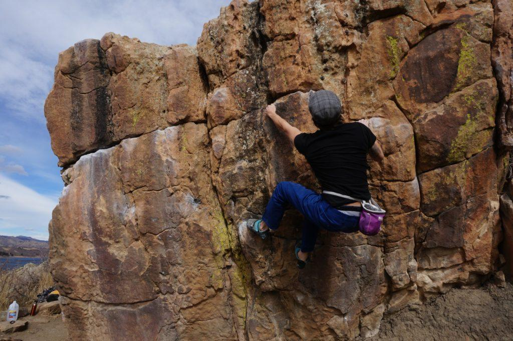 student on Horsetooth bouldering