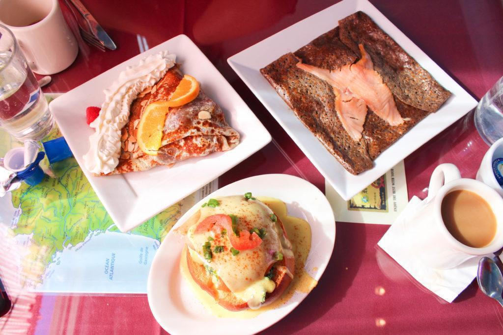 plates of food: Clockwise: the Suzette crepe, Professeur Steve galette, cocotte brioche.