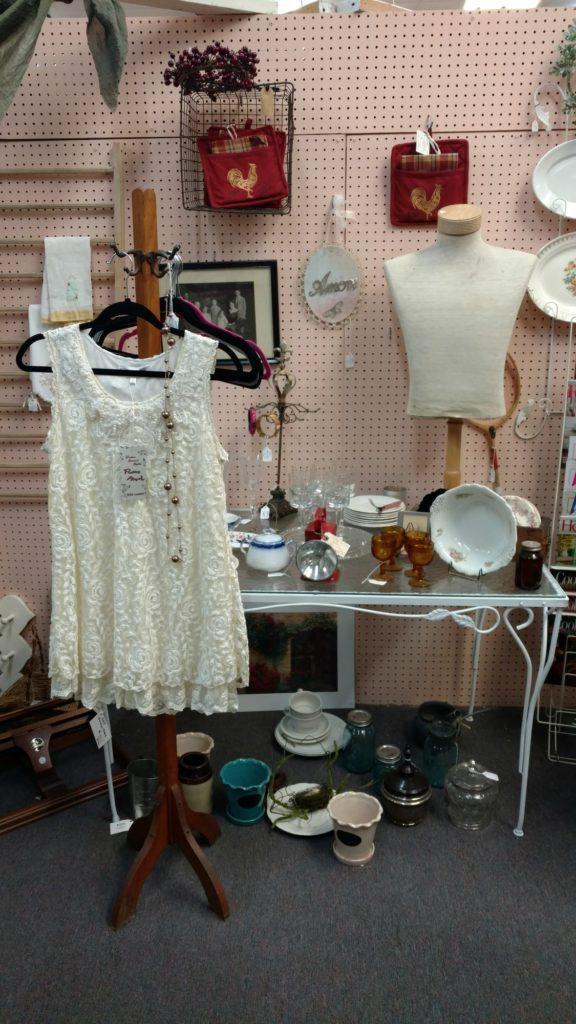 White dress and ceramics at Foothills Flea Market. Photo credit: Fynn Bailey
