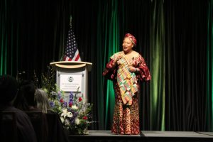 Gbowee walking the stage during her speech.