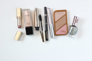 arrangement of peach and pink makeup products