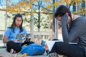 Aleesha bun, a biochemistry major, and Mia Salem, an engineering major, study for a calculus exam outside Morgan Library. Freshman year has taken full swing for them, as they tackle the stress head on. Photo credit: Olive Ancell