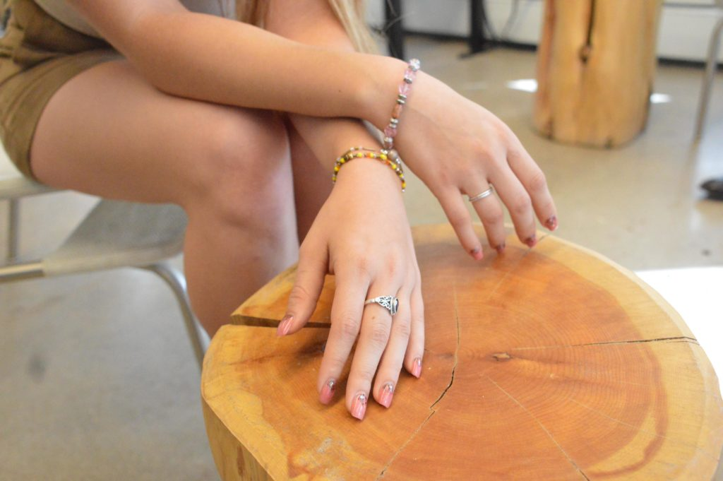 Bella Luna Treasures Co-owner Amber Brill models some of her homemade jewelry Oct. 14. Brill often models for the company, along with running the company alongside co-owner Hailey Sorensen. (AJ Frankson | Collegian)