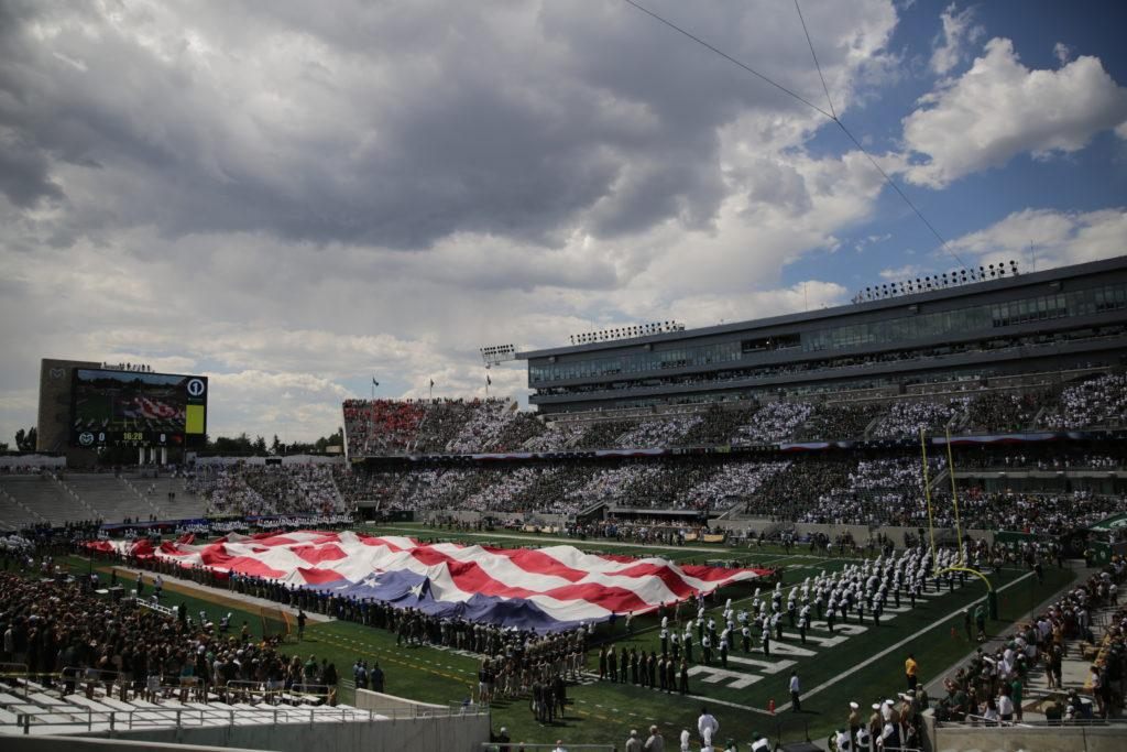 A football-field sized American flag is unfurled before the start of Colorado State University's first football game of the season against Oregon State, on Saturday, August 26th.