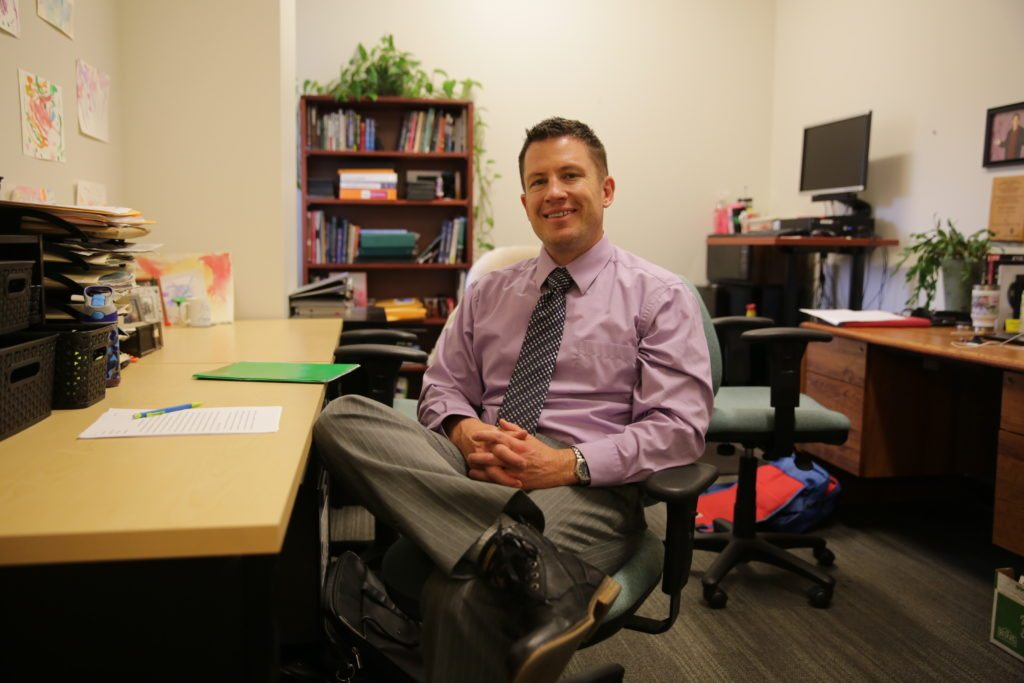 Professor Kurt North in his office, located in the Behavioral Sciences building.