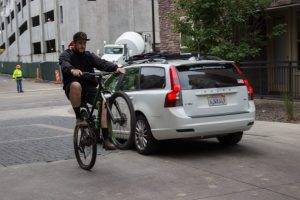 Jimmy Yoder shows off his biking skills by pops a wheelie.