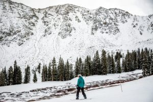 skier in front of snowy colorado mountain