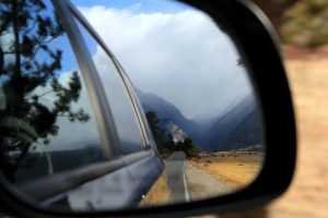 The mountains and road reflected in this car mirror represent life's journey. Photo credit: Kelly Peterson