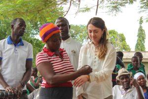 student receiving beaded bracelet