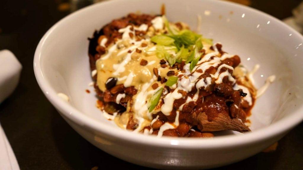 Tasty Harmony's baked yam with chocolate chili and cashew cheese.