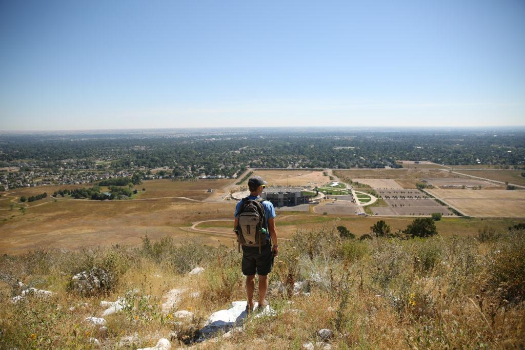 student looking out over Fort Collins