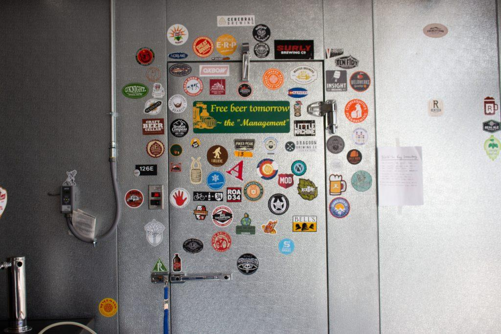 wall of stickers on a door to the fermentation lab