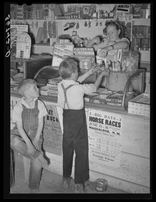 Farm children buying candy at the general store at Pie Town, New Mexico. Black and white photo from 1940.