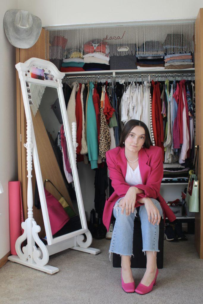 (From Fast Fashion to Sustainable Styles)Sara VanHatten sits before her closet full of unique clothing