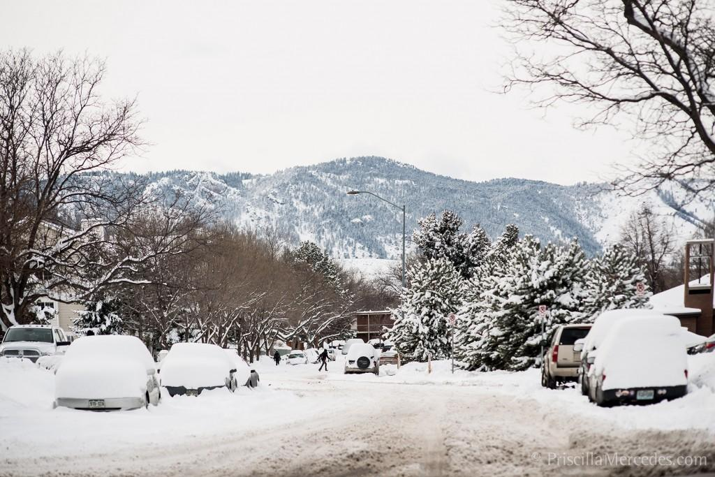 snowy street with foothills in the background