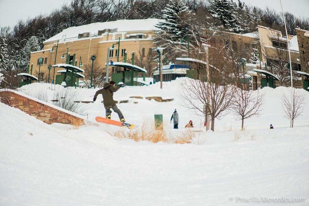 CSU student snowboarding down the hill by the Lagoon.