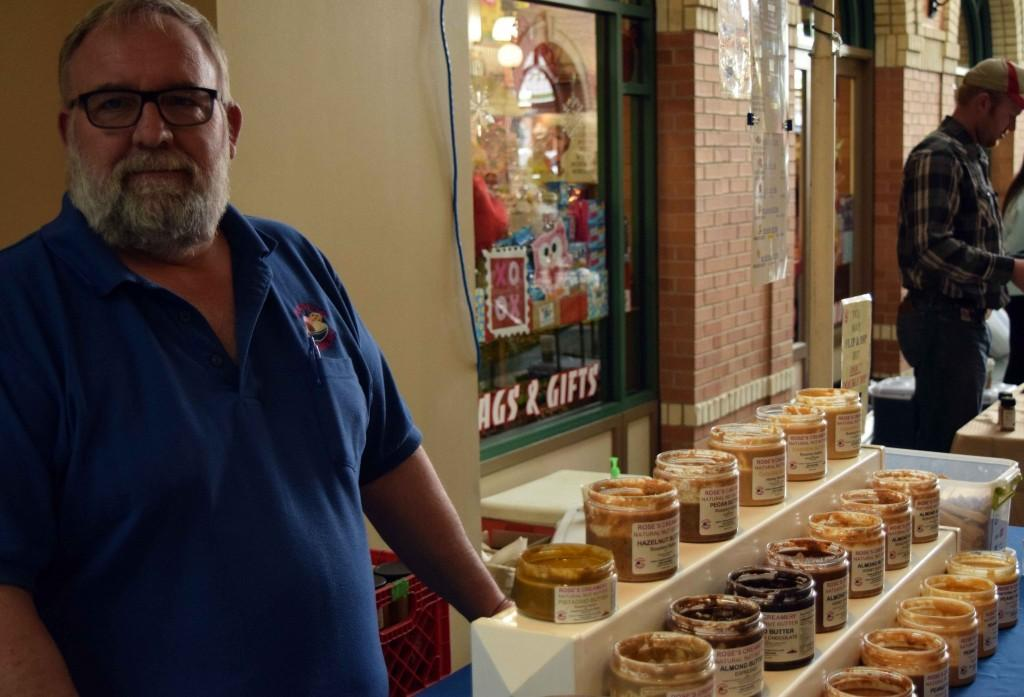 employee manning display of jars of nut and creams