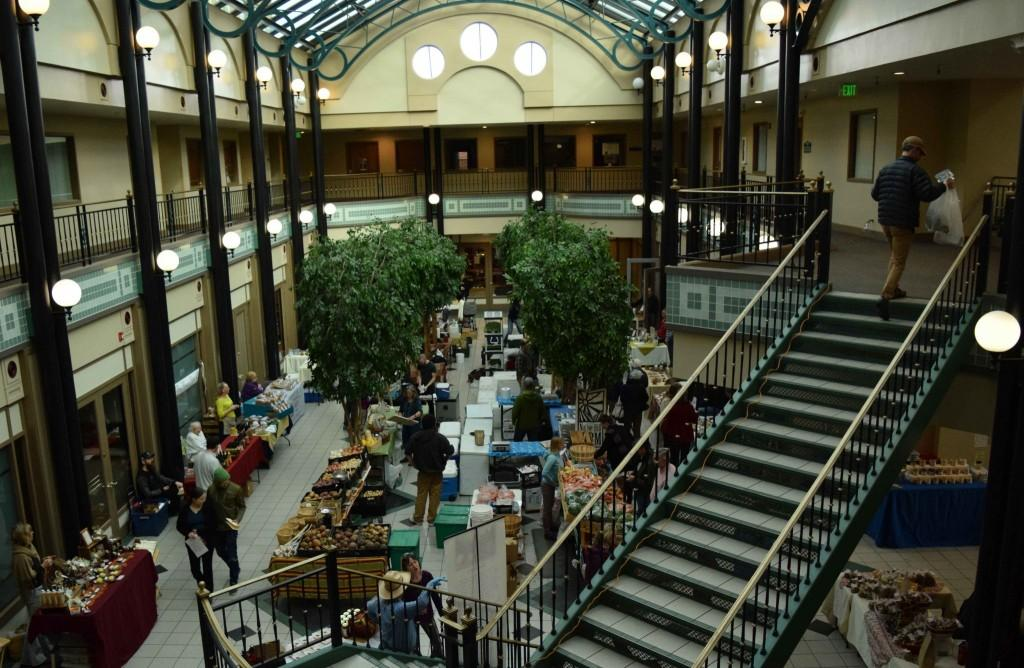 second-story view of the farmer's market below in the Opera Galleria